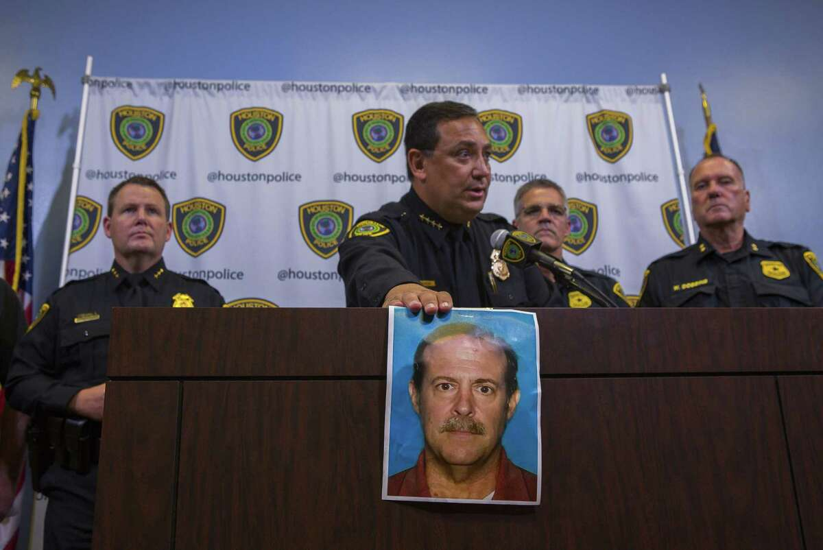 Houston Police Chief Art Acevedo identifies Joseph James Pappas as the suspect in the slaying of Dr. Mark Hausknecht during a press conference at HPD headquarters, Wednesday, Aug. 1, 2018 in Houston. The suspect, Joseph James Pappas, 65, is now wanted on an arrest warrant and is considered to be suicidal and dangerous. Pappas' mother was one of Hausknecht's former patients who died during surgery over 20 years ago, providing a motive in the killing, the chief said during a press conference Wednesday.