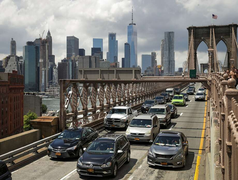 NEW YORK, NY - AUGUST 2: Traffic moves across the Brooklyn Bridge, August 2, 2018 in New York City. On Thursday, the Trump administration announced a proposal to weaken fuel-efficiency requirements for the nation's cars and trucks. The rollback is likely to spark legal challenges from California and other states. (Photo by Drew Angerer/Getty Images) Photo: Drew Angerer / Getty Images