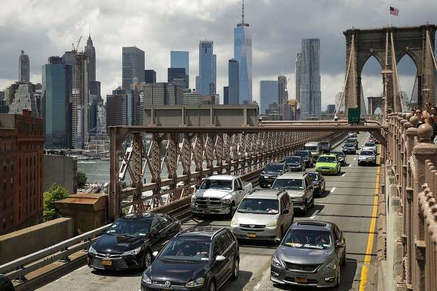 NEW YORK, NY - AUGUST 2: Traffic moves across the Brooklyn Bridge, August 2, 2018 in New York City. On Thursday, the Trump administration announced a proposal to weaken fuel-efficiency requirements for the nation's cars and trucks. The rollback is likely to spark legal challenges from California and other states. (Photo by Drew Angerer/Getty Images)