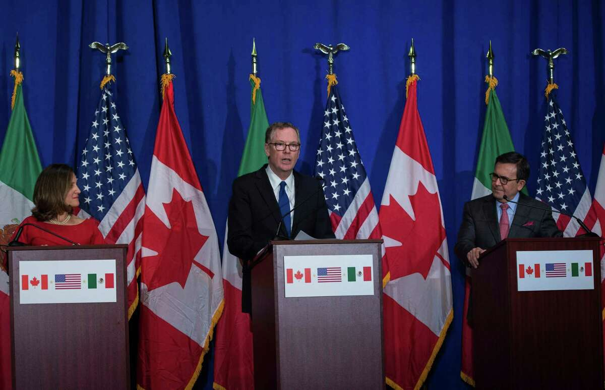 """(FILES) In this file photo taken on October 17, 2017 United States Trade Representative Robert Lighthizer (C), Canadian Foreign Affairs minister Chrystia Freeland (L), and Mexican Secretary of Economy Ildefonso Guajardo Villarreal hold a press conference at the conclusion of the fourth round of negotiations for a new North American Free Trade Agreement (NAFTA) at the General Services Administration headquarters in Washington, DC. US and Mexican officials said Thursday, July 26, 2018m they are aiming to conclude talks to remake the North American Free Trade Agreement as soon as next month. The new follows Wednesday's ceasefire in trade hostilities between the United States and the European Union, raising the possibility President Donald Trump could declare victory in two fronts of his global trade offensive. The US, Mexico and Canada could reach """"some kind of conclusion during the course of August,"""" US Trade Representative Robert Lighthizer told a Senate subcommittee. / AFP PHOTO / ANDREW CABALLERO-REYNOLDSANDREW CABALLERO-REYNOLDS/AFP/Getty Images"""