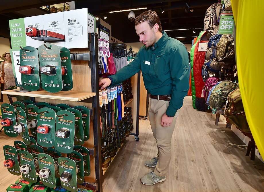 Micahl Derosa, an employee at L.L. Bean straightens the Chums eyewear retainers in the new urban style 8,000-square-foot retail store Thursday, August 2, 2018, at the Shops at Yale at Broadway in New Haven. The first 200 customers will receive a gift card beginning at 6 a.m. on Friday. There will be activities all weekend. Photo: Catherine Avalone, Hearst Connecticut Media