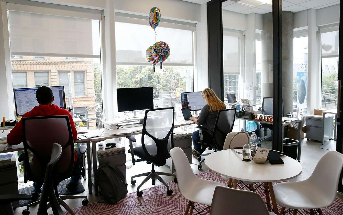 Rauxa employees work in the marketing agency�s corner suite at the Spaces shared co-working offices at Third and Mission streets in San Francisco, Calif. on Thursday, Aug. 2, 2018.