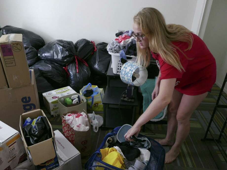 Bobbi Yanoviak, a student at Texas State University, is packing to move on Aug. 2, 2018, from her apartment in Building 100 at Iconic Village Apartments in San Marcos. She decided to move after a fire killed five people in Building 500 on July 20. Photo: Billy Calzada /Staff Photographer / Billy Calzada
