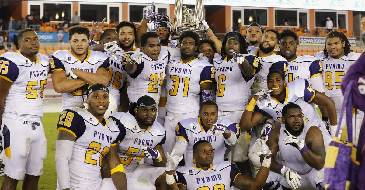 The Prairie View A&M Panthers pose with The Durley-Nicks Traveling Trophy after the NCAA football game between the Prairie View A&M Panthers and the Texas Southern Tigers at BBVA Compass Stadium in Houston, TX on Saturday, November 25, 2017. The Panthers defeated the Tigers 30-16.