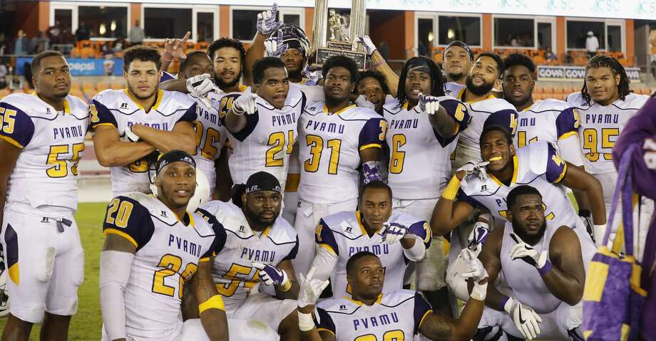 The Prairie View A&M Panthers pose with The Durley-Nicks Traveling Trophy after the NCAA football game between the Prairie View A&M Panthers and the Texas Southern Tigers at BBVA Compass Stadium in Houston, TX on Saturday, November 25, 2017.  The Panthers defeated the Tigers 30-16. Photo: Tim Warner/For The Chronicle
