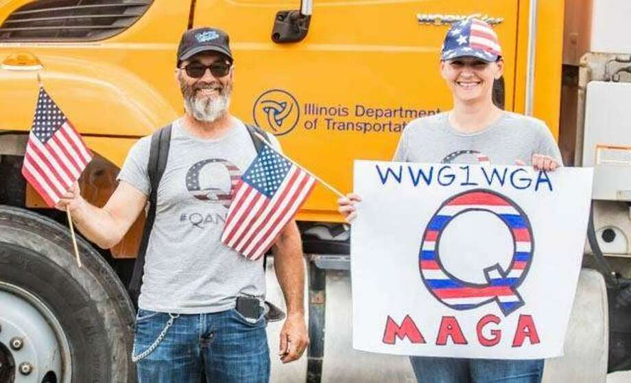 "Members of the ""QAnon"" faction of President Donald Trump supporters show their pride last Thursday during the presidential visit to the U.S. Steel Granite City Works plant. Photo:     Nathan Woodside 