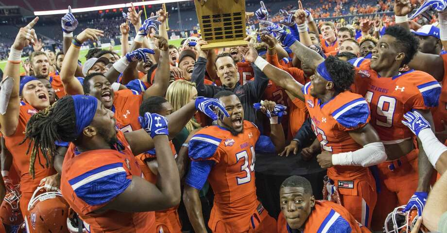PHOTOS: A look at last year's Battle of the Piney Woods Sam Houston State head coach K.C. Keeler holds up the Battle of the Piney Woods trophy after defeating Stephen F. Austin 63-28 in a NCAA Football Championship Subdivision football game at NRG Stadium on Saturday, October 1, 2016, in Houston. (Joe Buvid / For the Houston Chronicle) Photo: Joe Buvid/For The Houston Chronicle