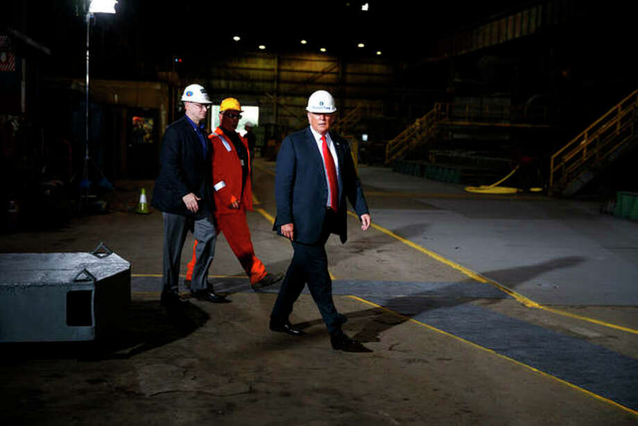 President Donald Trump participates in a tour of Granite City Works Hot Strip Mill on July 26 in Granite City. Evan Vucci | AP