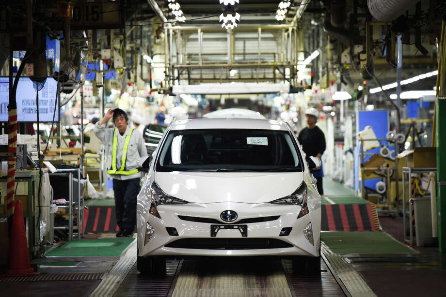 A new Prius hybrid automobile stands on the final quality check production line at the Toyota plant.