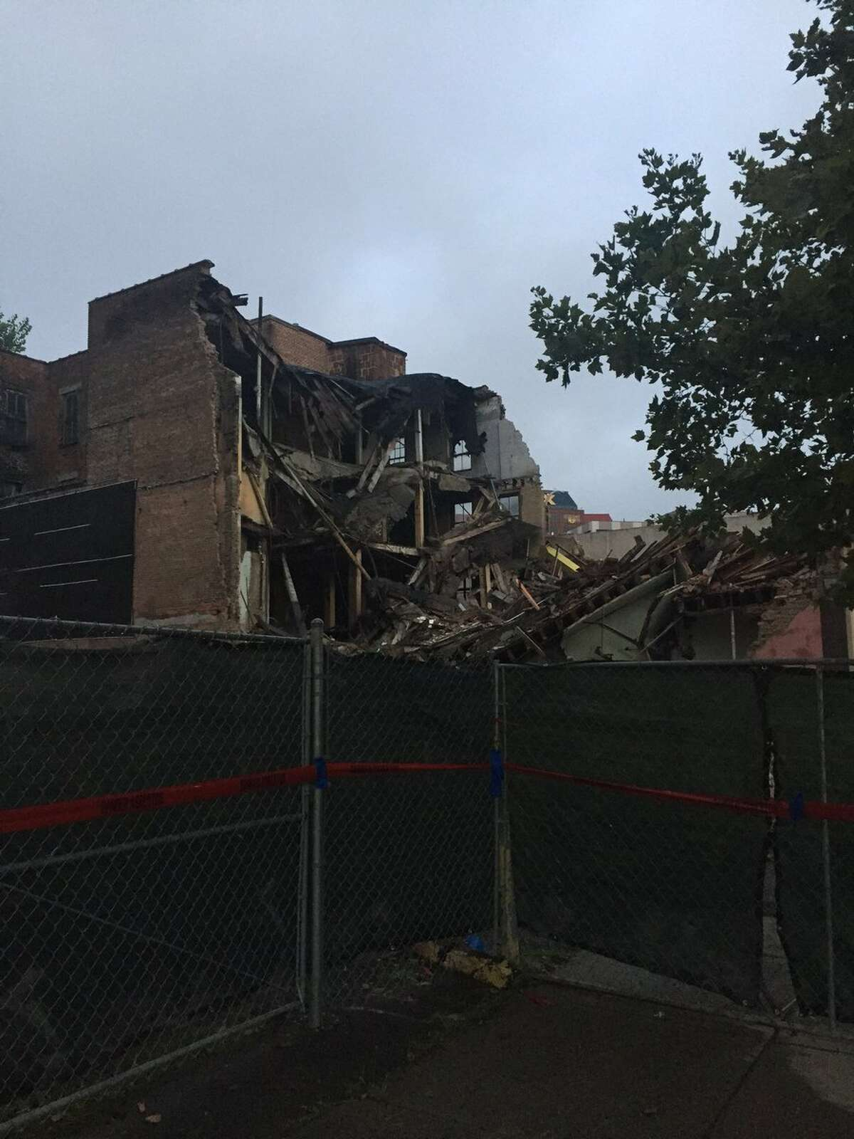 Demolition is partially completed early Friday, Aug. 3, 2018, of 6 E-Comm in Albany, where an emergency demolition was ordered on Thursday. (Amanda Fries/Times Union)