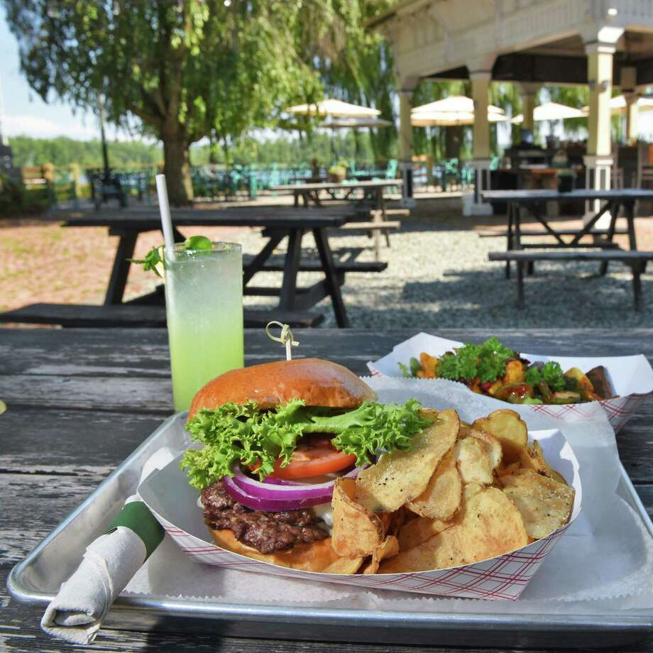 A Smash Burger at the The River Grill, an outside kitchen and dining space on the banks of the Hudson River at Stewart House Thursday July 26, 2018 in Athens, NY.  (John Carl D'Annibale/Times Union) Photo: John Carl D'Annibale / 20044430A