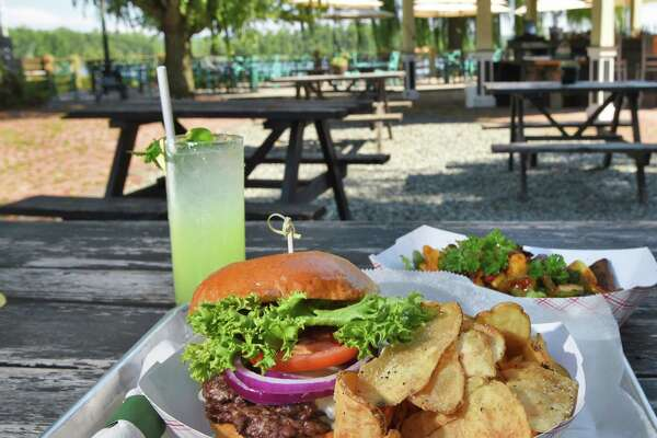 A Smash Burger at the The River Grill, an outside kitchen and dining space on the banks of the Hudson River at Stewart House Thursday July 26, 2018 in Athens, NY. (John Carl D'Annibale/Times Union)