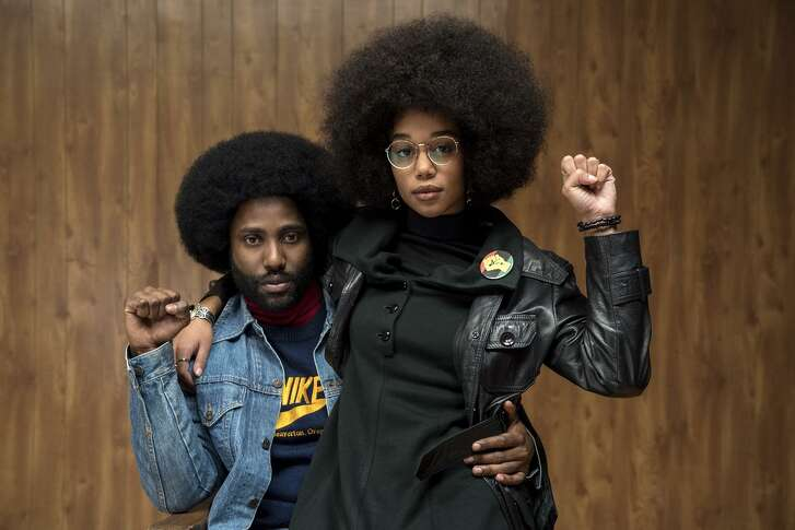 "John David Washington stars as Ron Stallworth and Laura Harrier as Patrice in Spike Lee's ""BlacKkKlansman."""