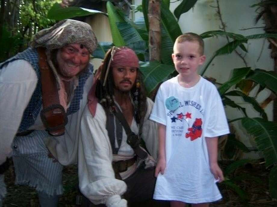 Josh Roy, facing open heart surgery when he was 5, had the chance to meet Jack Sparrow — played by actor Johnny Depp — an opportunity provided by the charity Special Wishes. Photo: Contributed Photo /