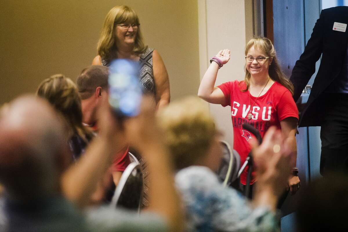 Jessica Day smiles as she walks into a surprise celebration during which she was told she is receiving the Ruby's Rainbow Scholarship on Friday, Aug. 3, 2018 at Saginaw Valley State University. Ruby's Rainbow provides scholarships for adults with Down Syndrome who have dreams of pursuing higher education. (Katy Kildee/kkildee@mdn.net)