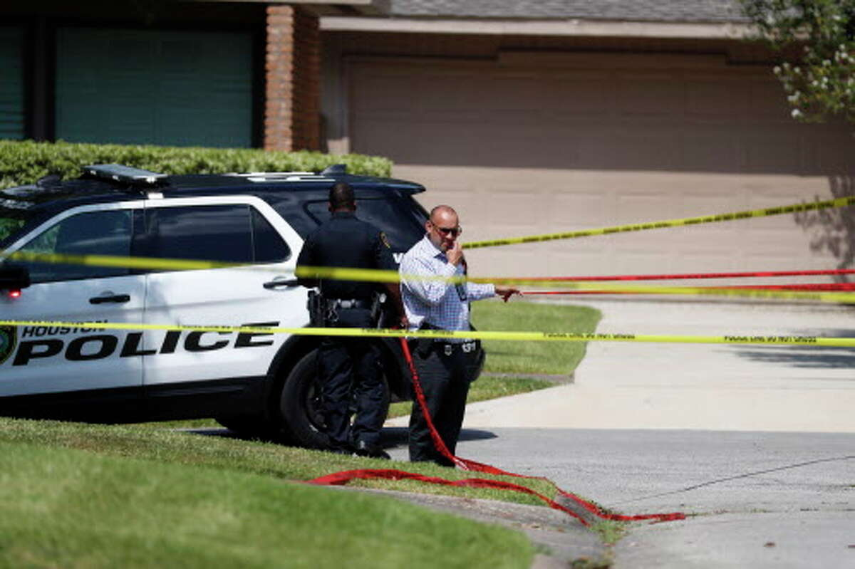 Houston Police set up police lines around the area on Bob White Drive, after police say Joseph James Pappas, the suspect in the murder of Dr. Mark Hausknecht, shot himself, August 3, 2018 in Houston.
