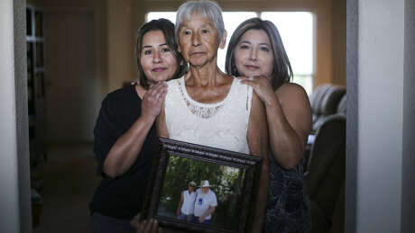 Noemi Barnard holds a photo of her late husband, Ernest Barnard, with her daughters, Graciella Gonzalez, left and Gloria Bivens on Thursday, July 12, 2018 in Katy. He passed away after complications from a heart bypass surgery at St. Luke's Hospital in Houston.