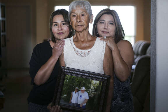 Noemi Barnard holds a photo of her late husband, Ernest Barnard, with her daughters, Graciella Gonzalez, left and GloriaBivenson Thursday, July 12, 2018 in Katy. He passed away after complications from a heart bypass surgery at St. Luke's Hospital in Houston.