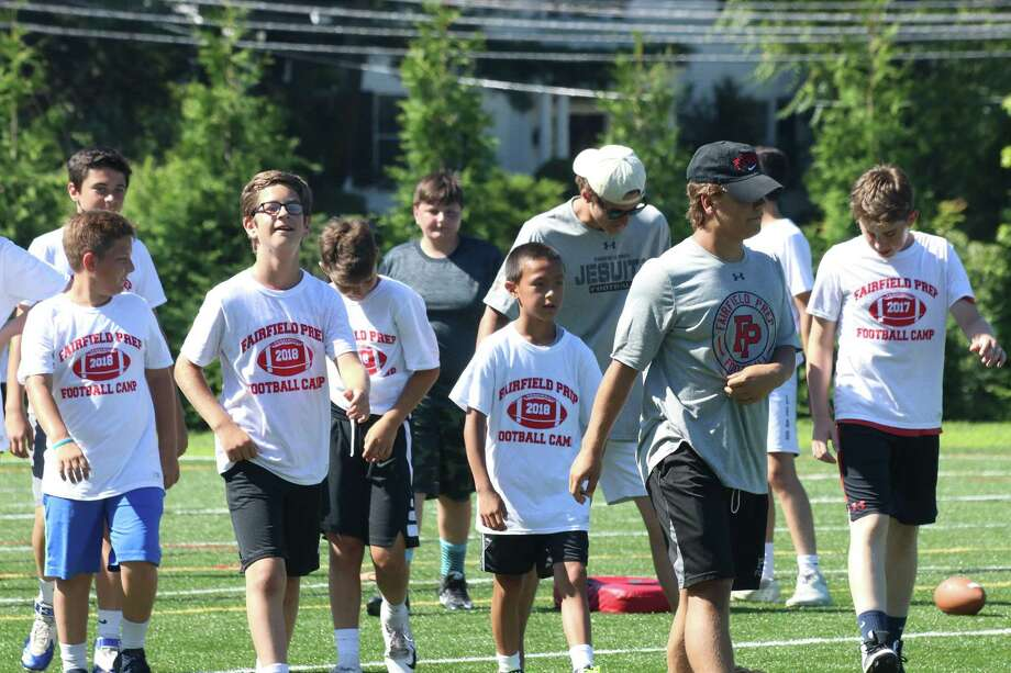 Fairfield Prep football coach Keith Hellstern held his third summer camp recently and some 70 campers, ages 11 to 14, participated. Photo: Contributed Photo