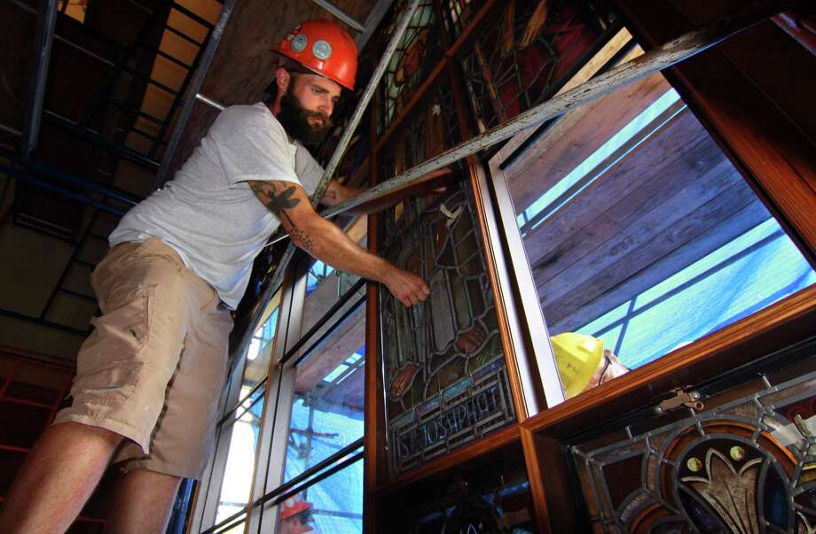 Chad Gumlaw, a worker from Stained Glass Resources Inc. from Massachusetts prepares to install a restored panel of stained glass at St. Peter and St. Paul Ukrainian Catholic Church in Ansonia, Conn., on Wednesday Aug. 1, 2018. The company installed the second of two enormous stained glass windows, originally made in Austria. The windows were repaired at a cost of over $350,000. Photo: Christian Abraham / Hearst Connecticut Media / Connecticut Post