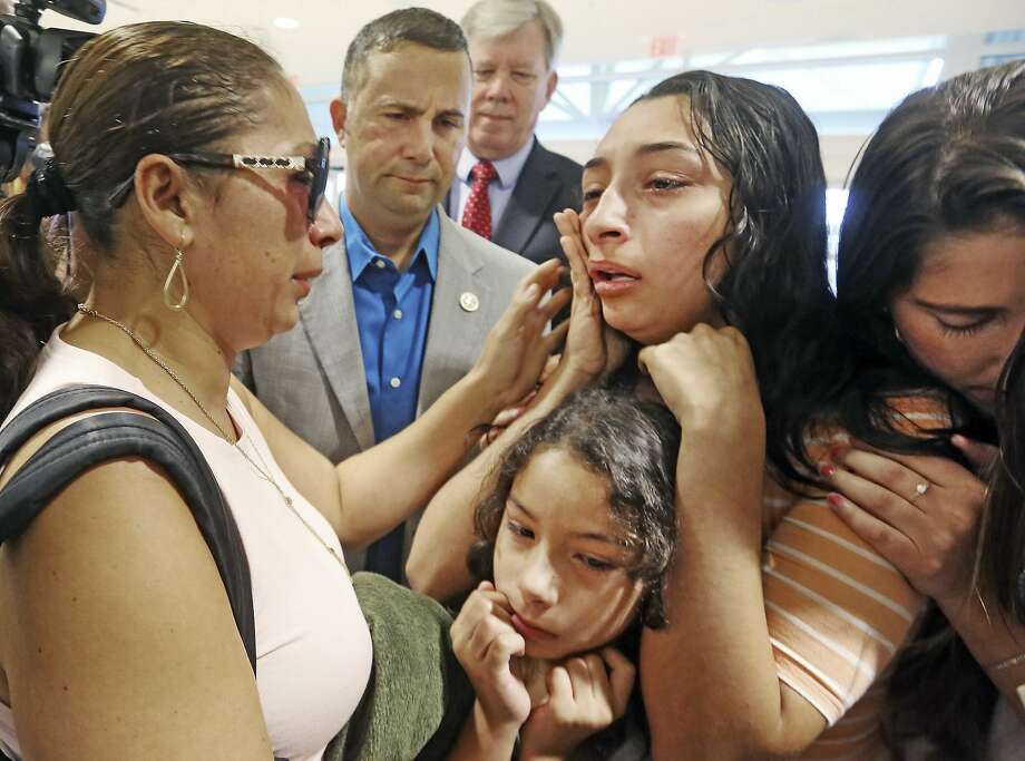 CORRECTS AGE TO 39-Alejandra Juarez,39, left, says goodbye to her children, Pamela and  Estela at the Orlando International Airport on Friday, Aug. 3, 2018 in Orlando, Fla.  Juarez, the wife of a former Marine is preparing to self-deport to Mexico in a move that would split up their family.  (Red Huber/Orlando Sentinel via AP) Photo: Red Huber / Associated Press