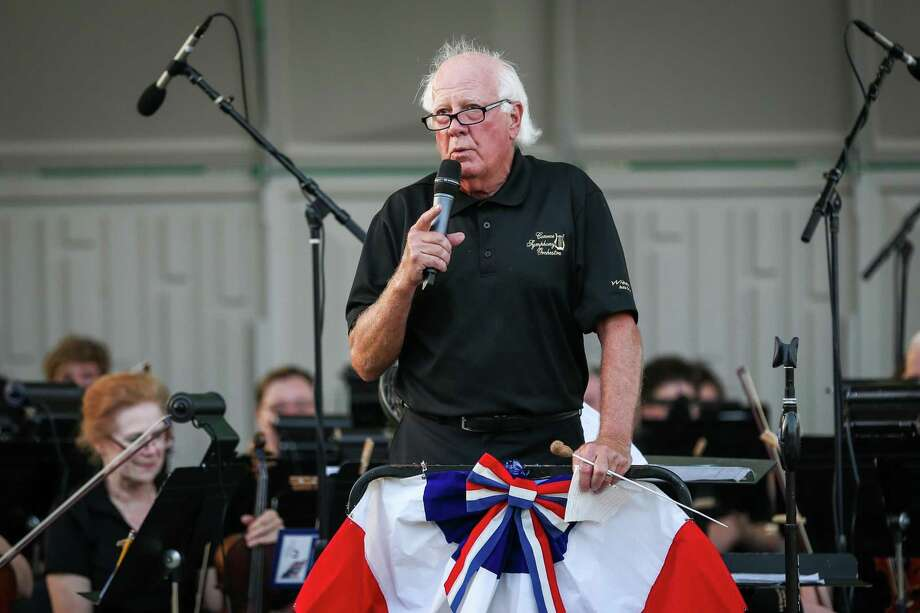 Don Hutson, conductor and music director of the Conroe Symphony Orchestra, speaks to the audience during the Patriotic Celebration concert on Saturday, June 30, 2018, at Heritage Place Park. Hutson will step down as the conductor and music director next summer. Photo: Michael Minasi, Staff Photographer / Houston Chronicle / © 2018 Houston Chronicle