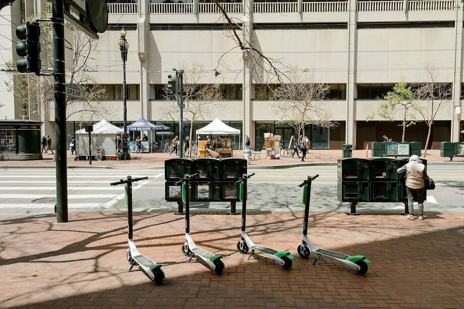 FILE -- Scooters on the sidewalk in downtown San Francisco, Calif., April 14, 2018. Doctors and public health workers in San Francisco are preparing to track injuries from electric scooters and the other transportation services blossoming in the city. (Jason Henry/The New York Times) Photo: Jason Henry, NYT