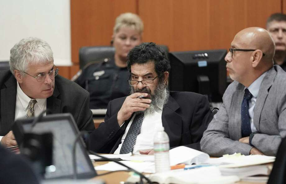 In this June 25, 2018 photo,  Ali Mahwood-Awad Irsan, center, sits in court with his defense attorneys Allen Tanner, left, and Rudy Duarte, right, in Houston. Irsan, a 60-year-old Jordanian-American, is charged with capital murder, accused of killing his daughter's husband and her best friend, an Iranian activist.  (Melissa Phillip/Houston Chronicle via AP) Photo: Melissa Phillip, MBO / Associated Press / © 2018 Houston Chronicle
