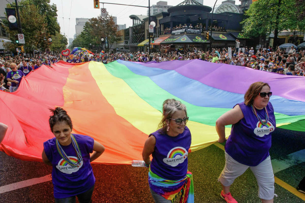 """Vancouver Pride Parade: Our neighbor to the north puts on a Pride Parade that is every bit as much of a blast as its Seattle counterpart. We get local politicians. They had Canada's Prime Minister Justin Trudeau marching and cavorting two years ago. The 40th anniversary parade begins at 11 a.m. at Robson and Thurlow, swings west down """"Robsonstrasse,"""" hangs a left on Denman, and then swings back along Beach Avenue. There is a big rousing party at Sunset Beach with a stage, a family-friendly fun zone, and a beer garden."""
