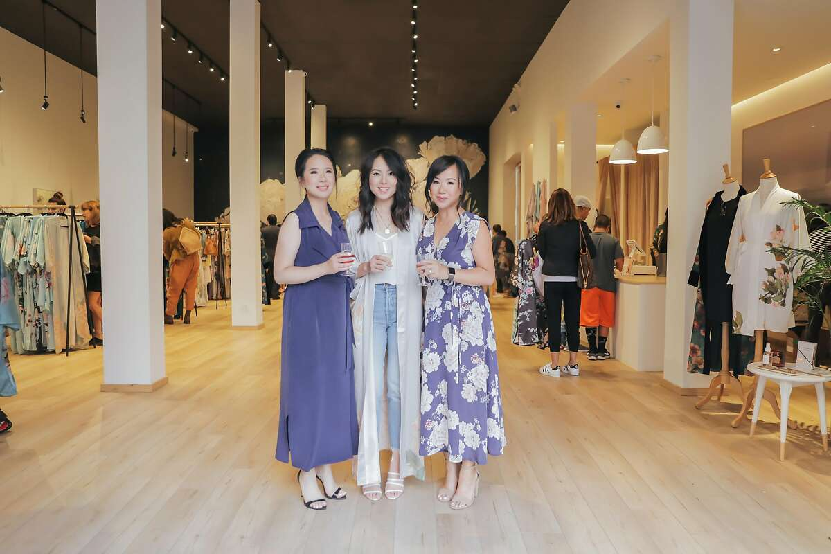 Tiffany Tam (left), Fancy Pants Report blogger Kate Ogata and��Renee Tam (flowered dress) at the July 12 launch party for their store Kim + Ono in Chinatown.