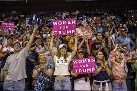 """Attendees hold """"Women for Trump"""" signs as U.S. President Donald Trump, not pictured, addresses the crowd during a rally in Wilkes-Barre, Pennsylvania, U.S., on Thursday, Aug. 2, 2018. Trump tweeted Thursday that Pennsylvania has to love him because he's """"bringing STEEL BACK in a VERY BIG way."""" Photographer: Victor J. Blue/Bloomberg"""
