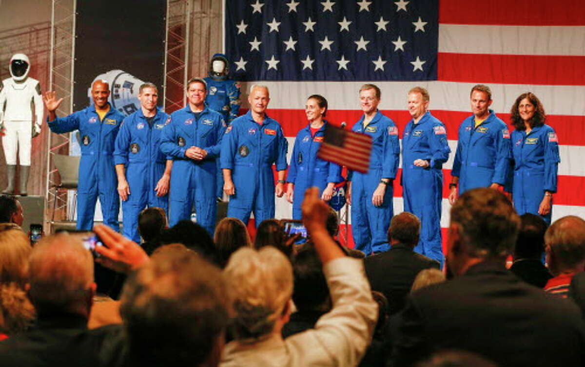Astronauts Victor Glover (left-right), Mike Hopkins, Bob Behnken, Doug Hurley, Nicole Mann, Chris Ferguson, Eric Boe, Josh Cassada, Suni Williams receive applause Friday, Aug. 3, 2018, in Houston. NASA Administrator Jim Bridenstine announced the crew assignments for the crew flight tests and the first post-certification mission for both Boeing and SpaceX. >>These are the SpaceX projects on the drawing board...