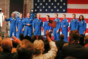 Astronauts Victor Glover (left-right), Mike Hopkins, Bob Behnken, Doug Hurley, Nicole Mann, Chris Ferguson, Eric Boe, Josh Cassada, Suni Williams receive applause Friday, Aug. 3, 2018, in Houston. NASA Administrator Jim Bridenstine announced the crew assignments for the crew flight tests and the first post-certification mission for both Boeing and SpaceX.