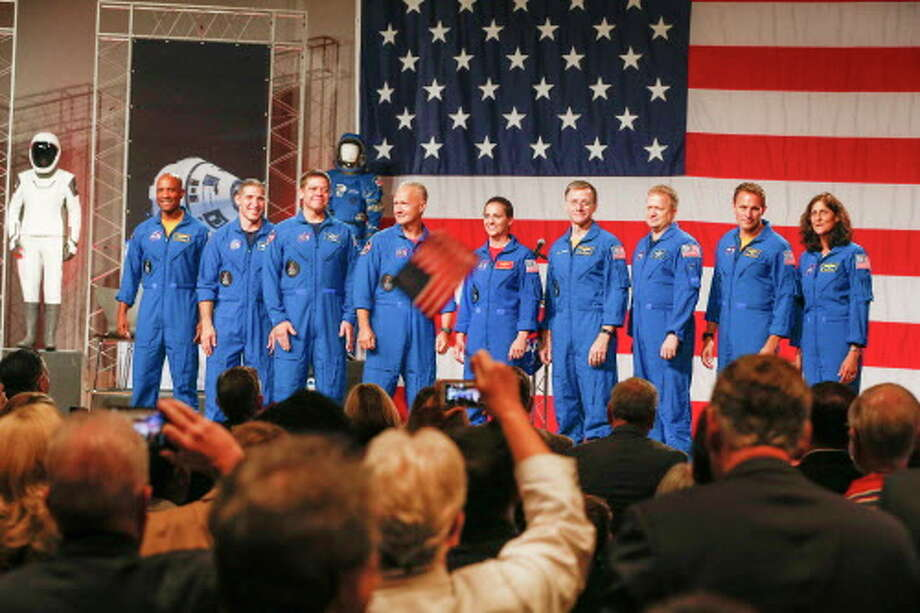 Astronauts Victor Glover (left-right), Mike Hopkins, Bob Behnken, Doug Hurley, Nicole Mann, Chris Ferguson, Eric Boe, Josh Cassada, Suni Williams receive applause Friday, Aug. 3, 2018, in Houston. NASA Administrator Jim Bridenstine announced the crew assignments for the crew flight tests and the first post-certification mission for both Boeing and SpaceX. Photo: Steve Gonzales, Houston Chronicle / © 2018 Houston Chronicle