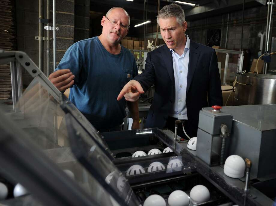 David Stemerman, right, visits the Wiffle Ball factory in Shelton. last month. Photo: Brian A. Pounds / Hearst Connecticut Media / Connecticut Post