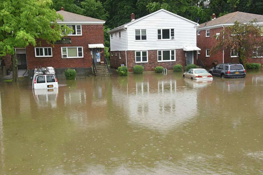 Flood water is seen half way up cars parked in driveways along Hackett Blvd. on Friday, Aug. 3, 2018 in Albany, N.Y. Heavy rains caused flash flooding in many areas of the Capital District. (Lori Van Buren/Times Union) Photo: Lori Van Buren, Albany Times Union
