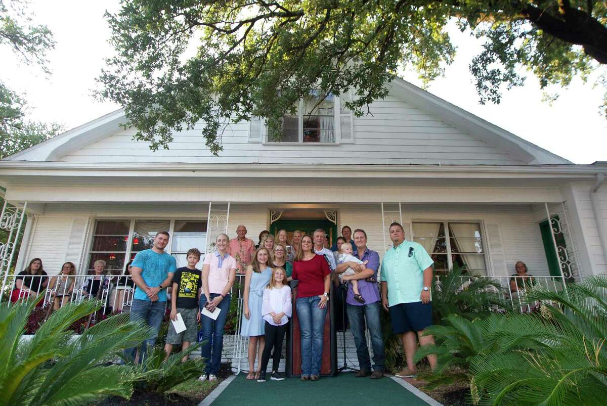 Descendants of Conroe founder Isaac Conroe pose for a photo in front of the family's historic house during the inaugural Conroe Founder's Day on Thursday, Aug. 2, 2018, in Conroe.