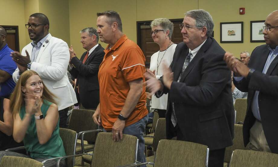 Midland ISD employees stand and applaud after Midland Commissioners Court announce a vote and approval of $5 million for schools 08/03/18 as the court gives out more than $11 million in sales tax money to area groups serving county residents. Tim Fischer/Reporter-Telegram Photo: Tim Fischer/Midland Reporter-Telegram