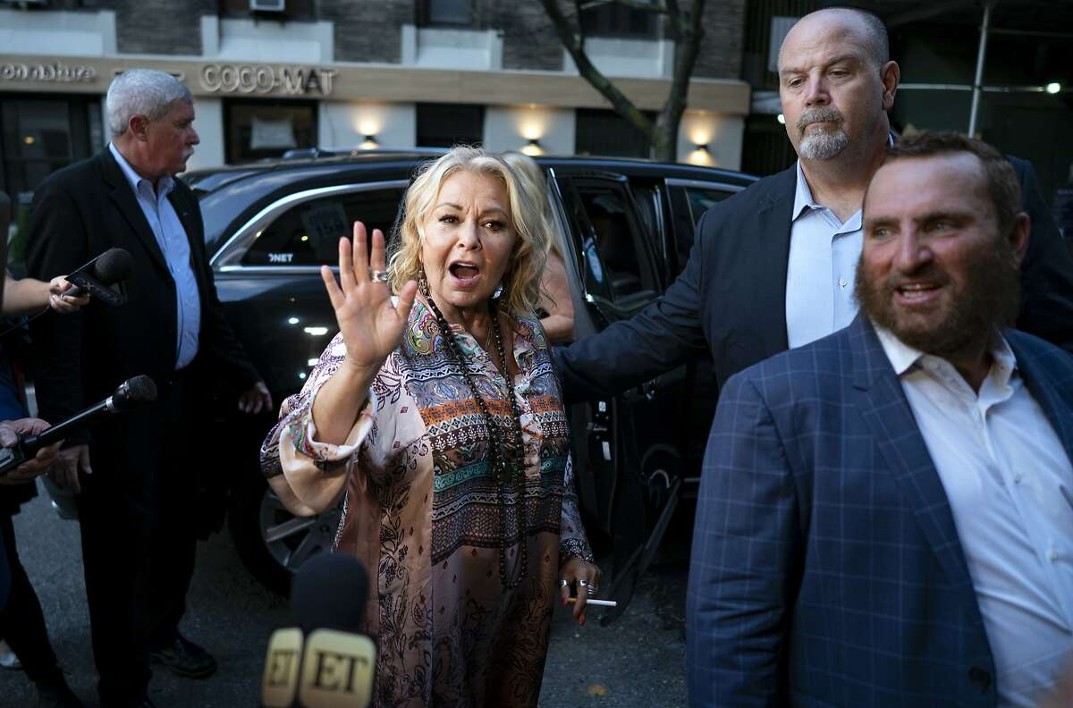 Comedian and actress Rosanne Barr, center, arrives to take part in a special event and podcast taping with Rabbi Shmuley Boteach, right, at Stand Up NY, Thursday, July 26, 2018, in New York. (AP Photo/Craig Ruttle)