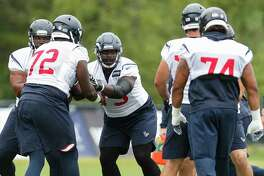 Houston Texans offensive guard Zach Fulton (73) runs a drill with his fellow offensive linemen during training camp at the Greenbrier Sports Performance Center on Friday, Aug. 3, 2018, in White Sulphur Springs, W.Va.