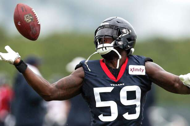 Houston Texans linebacker Whitney Mercilus tips the ball in the air while running through a drill during training camp at the Greenbrier Sports Performance Center on Friday, Aug. 3, 2018, in White Sulphur Springs, W.Va.