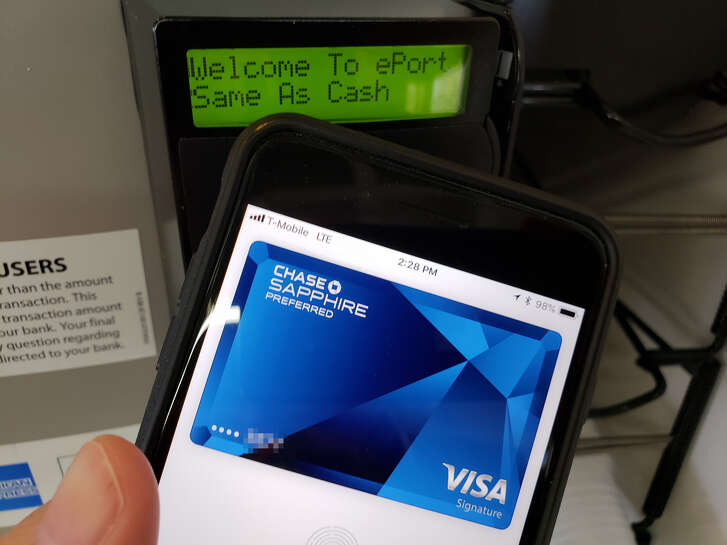Apple Pay uses an NFC chip to handle transactions with touchless terminals.