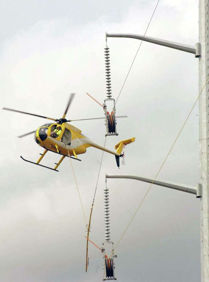 Eversource Energy will be using a helicopter to help string new high-voltage transmission lines on towers in Stratford and Milford, Conn., through Sept. 30. Photo: Contributed Photo / Hearst Connecticut Media