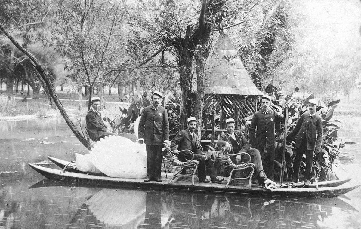 An 1891 photo of members of the San Antonio Volunteer Fire Department on a swan boat in San Pedro Park is among the works on display in