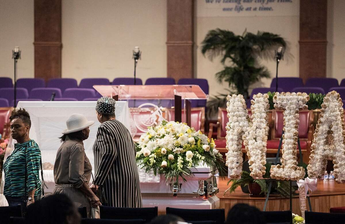 Mourners pay their respects during a funeral service held for 18-year-old Nia Wilson of Oakland at Acts Full Gospel Church in Oakland, Calif. Friday, Aug. 3, 2018. Wilson was killed Sunday, July 22, 2018 at Macarthur Bart station in Oakland, Calif.