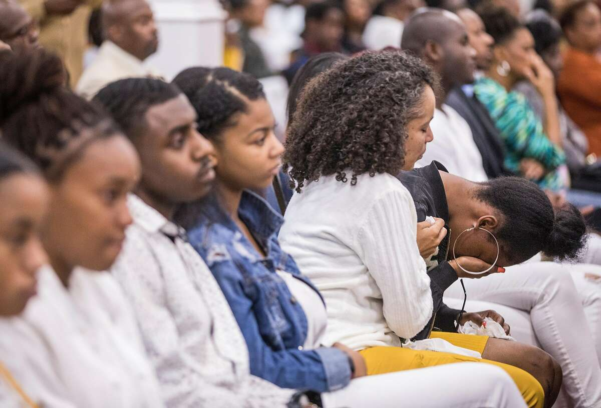 A woman cries during a funeral service held for 18-year-old Nia Wilson of Oakland at Acts Full Gospel Church in Oakland, Calif. Friday, Aug. 3, 2018. Wilson was killed Sunday, July 22, 2018 at Macarthur Bart station in Oakland, Calif.