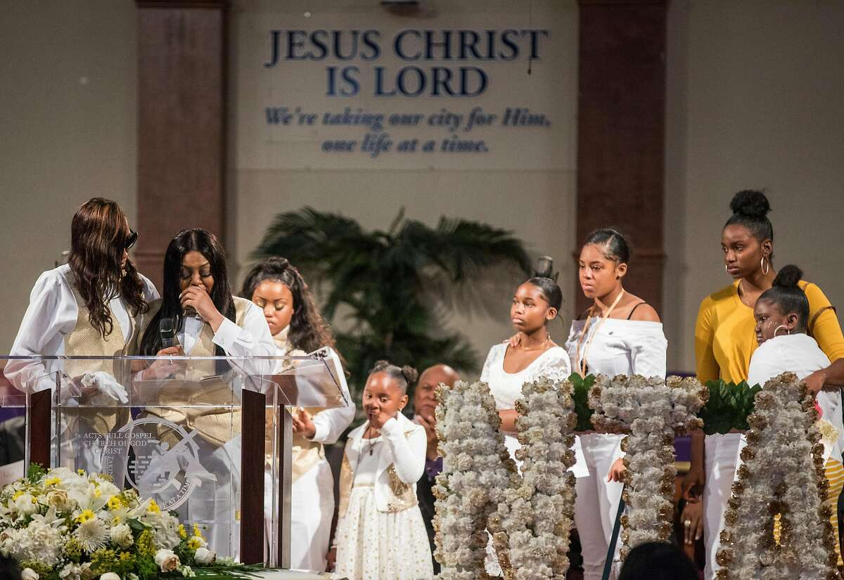La'tifa Wilson, second left, cries while standing with her family during a funeral service held for 18-year-old Nia Wilson of Oakland at Acts Full Gospel Church in Oakland, Calif. Friday, Aug. 3, 2018. Wilson was killed Sunday, July 22, 2018 at Macarthur Bart station in Oakland, Calif.