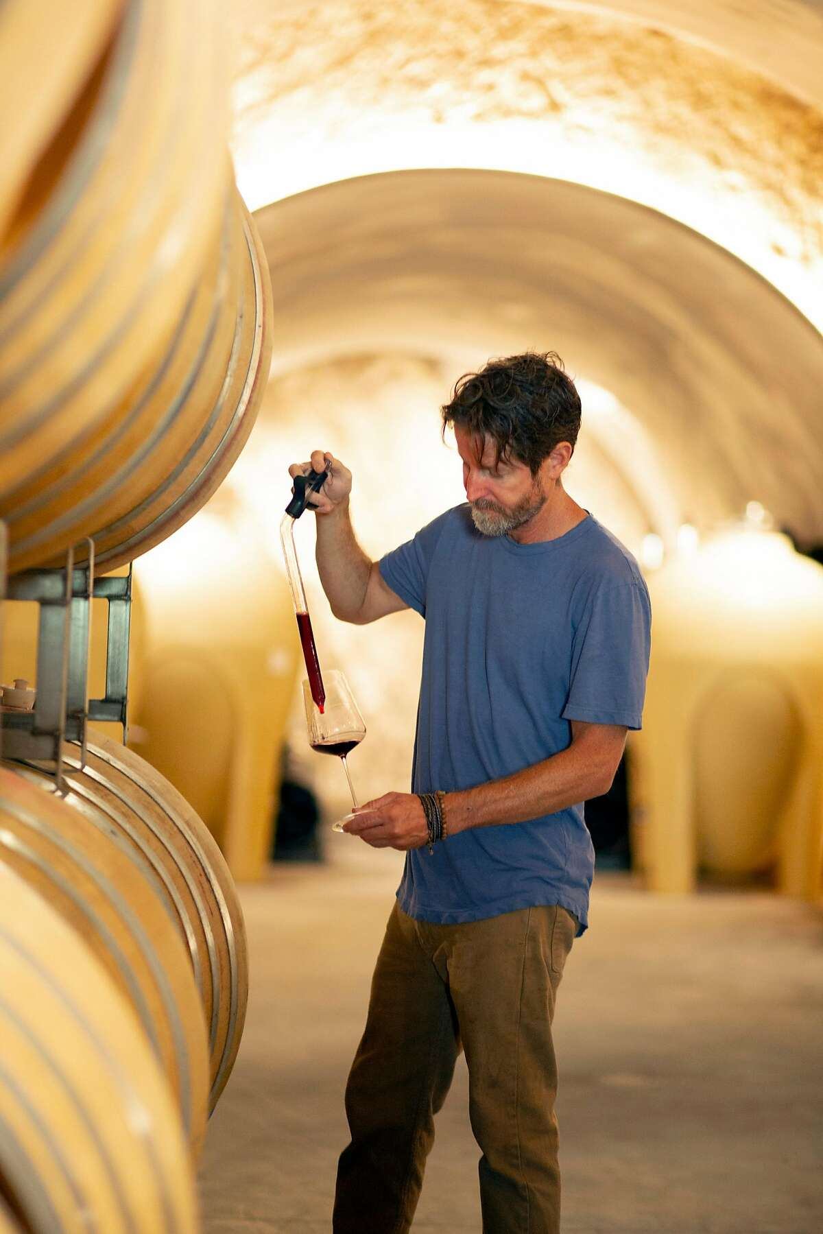Winemaker Justin Smith checks wine made from Graciano grapes at Saxum Vineyards on Friday, 8/3, 2018 near Paso Robles, California. Hundreds of thousands of plants believed to be a Spanish clone of the Mourvedre grape ultimately turned out to be Graciano, an obscure variety from Rioja.