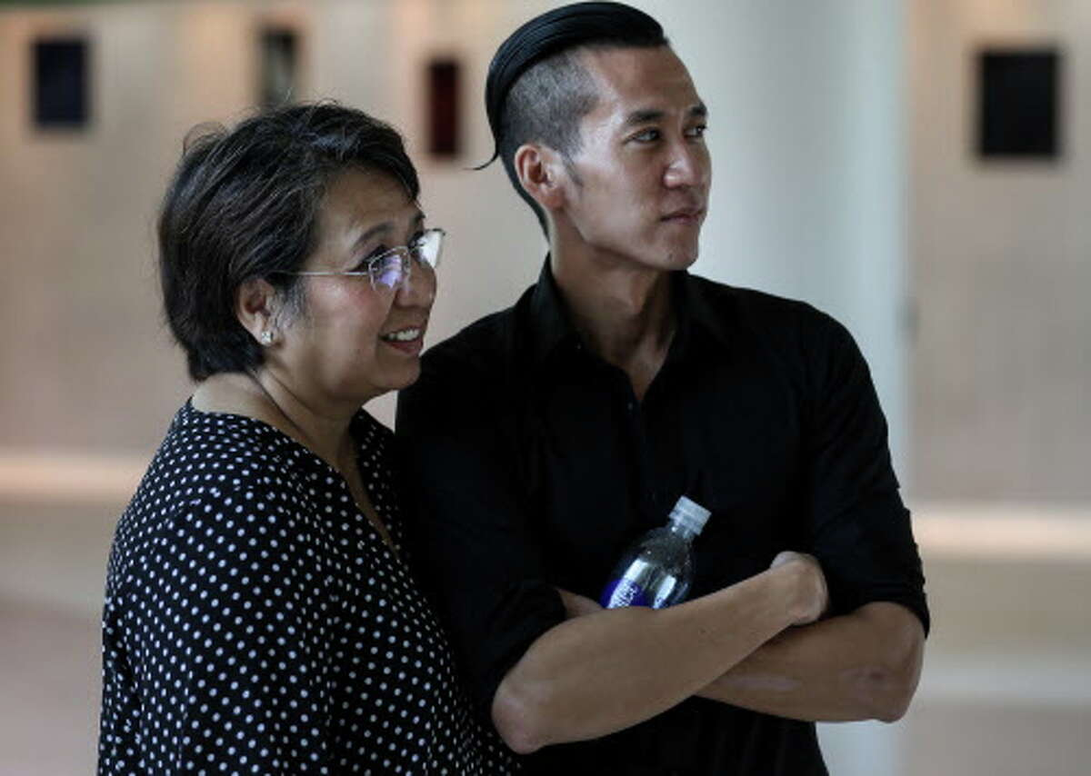 William Nguyen, right, stands with his mother Vicky Nguyen after arriving at Bush IAH, Friday, Aug. 3, 2018, in Houston. William Nguyen was held in a Vietnamese jail for 40 days, after being arrested during a protest in Ho Chi Minh City.