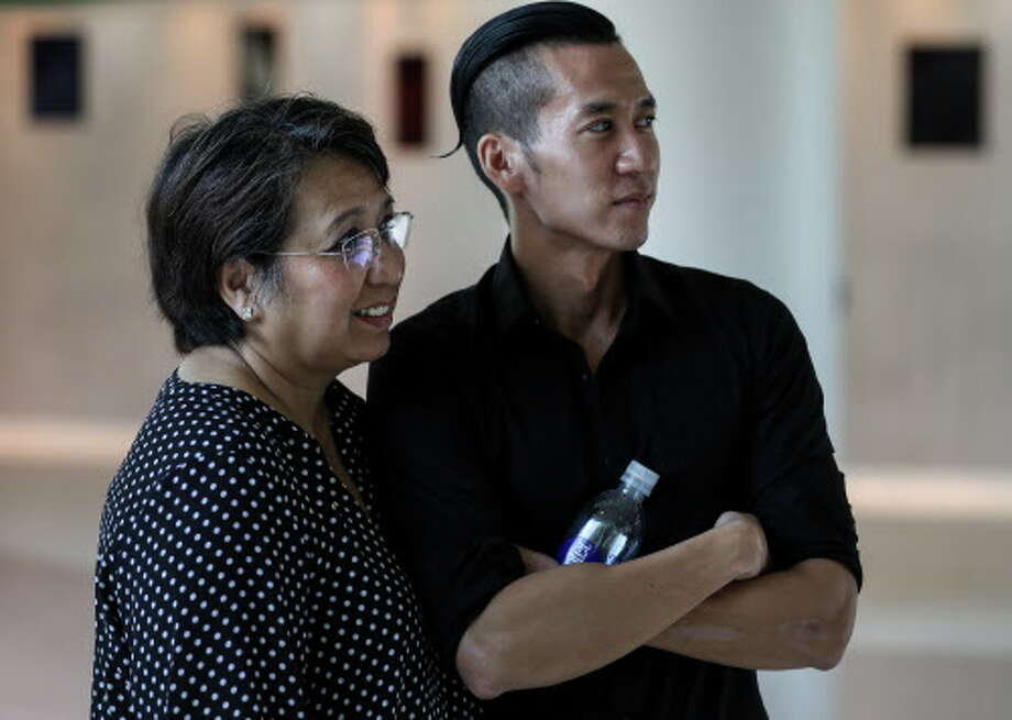 William Nguyen, right, stands with his mother Vicky Nguyen after arriving at Bush IAH, Friday, Aug. 3, 2018, in Houston. William Nguyen was held in a Vietnamese jail for 40 days, after being arrested during a protest in Ho Chi Minh City. Photo: Jon Shapley, Houston Chronicle / © 2018 Houston Chronicle